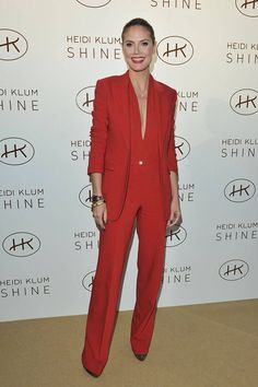 "Heidi Klum wears a red Michael Kors suit, sans blouse, to launch her fragrance ""Shine"" on November 29, 2011 in Toronto, Canada."