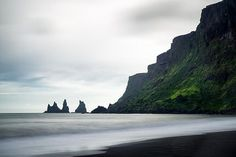 Reynisdrangar, Vik, South Iceland: Beach with black basalt sand, the fascinating sea stacks and cliffs and the water of the ocean. Pure Iceland! Click on the link or the image to buy a poster, fine art print or canvas print: http://matthias-hauser.artistwebsites.com/featured/iceland-beach-ocean-and-cliffs-vik-reynisdrangar-matthias-hauser.html 30 days money back guarantee. (c) Matthias Hauser hauserfoto.com - Art for your Home Decor and Interior Design needs.