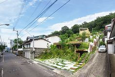 keita nagata builds greendo apartments into the landscape
