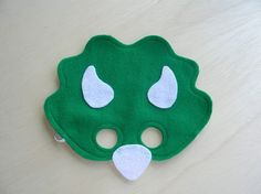Make these dino masks for a photo prop  Could try to modify it a bit to make a deco pillow for Keeg's reading area.