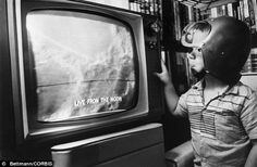 a child watched the first televised pictures of the moon in 1965