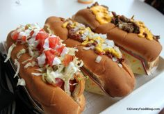 It's National Hot Dog Day! Check it out: Specialty Hot Dogs at The Lunching Pad in Walt Disney World's Magic Kingdom! #WDW #Disney