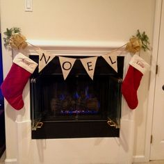 Our handmade Christmas banner made from burlap with our stockings and homemade bows.