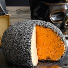 Try the Poppy Seed-Cheddar Cheese Ball Recipe on williams-sonoma.com.  Good for Halloween cheese tray.  Nice display at William Sonoma website.