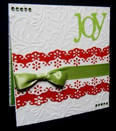 handmade Christmas card ... red, white and green ... embossing folder texture ... luf the use of MS edge punch to make a two layered belly band with the design enhanced with colors showing through from below ... die cut JOY ... merry and bright!!