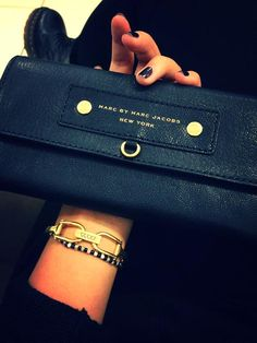 Marc Jacobs ♥ black leather wallet is a must! $$$ Wish I had the $$$$