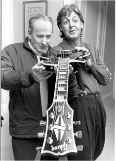 Les Paul, the man who invented one of music's iconic guitars, is celebrated in a traveling exhibit that will be coming to ASU on Friday. He's seen in this picture with Paul McCartney.