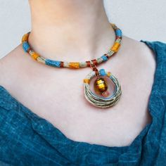 Items similar to African inspired tube collar in natural hemp, hemp jewelry, vegan gift for her, mustard and teal tribal necklace, native inspired jewelry on Etsy Hemp Jewelry, Hippie Jewelry, Unique Jewelry, Natural Jewelry, Anklet Bracelet, Anklets, Tribal Necklace, Beaded Necklace, Black And White Fabric
