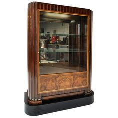 Art Deco Curio Cabinet in the style of Ruhlmann L 44 in. D 18 in. H 5 ft. 2 in. $13,000