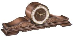 "Queensway: Reproduction of an antique tambour clock. Walnut finish with decorations and an elegant glass bezel. Mechanical brass 8-day Westminster chiming movement with silencing lever. Made in Germany. Brand: Hermle - Measures: H 9"" x W 17"" x D 5"" - Three year manufacturer's warranty - Free shipping within the contiguous United States - Found at http://www.theisenclock.com/tambour_mantel_clocks.html"