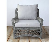 "Above: Santa Barbara-based interior designer Carole Magness likes the All-Weather Wicker collection from Terrain. Her favorite piece is the Curved Armchair shown here, which she says ""is just plain comfy, will last forever, and is so handsome."" It's $898."