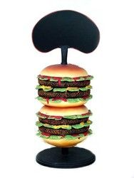 """This Delicious Looking 2' Hamburger Resin Statue comes fully dressed and sure to please! Life Like Hamburger Statue is Handcrafted Resin, Metal and Wood, Measures Approx. 15""""l x 15""""w x 22""""h and Weighs Approx 18 Lbs. Makes A great counter top Display to Advertise your Daily Specials. Shipping is Included in Price! Large Commercial Faux Food Displays - Ideal Decor for Events, and Fast Food Restaurants. Large Resin Food Displays! Butlers and Signs would like to welcome you to check out all of…"""