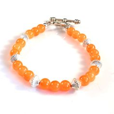 Women's Fluorescent Tangerine with Silver Accents Beaded Bracelet by DungleBees on Etsy