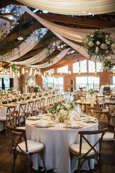 natural wedding décor barn reception decorated with white flowers and greenery brookeimages reception decorations 21 Natural Wedding Decor Ideas Wedding Ceiling Decorations, Ceiling Draping Wedding, Wedding Reception Table Decorations, Table Centerpieces, Natural Wedding Decor, Island Weddings, Wedding Table, Wedding Blog, Wedding Trends