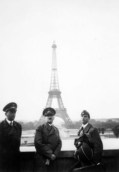 Hitler in Paris  Upon the Nazi occupation of Paris in 1940, Adolf Hitler posed in front of the Eiffel Tower with his architect Albert Speer (left) and his favorite sculptor Arno Breker. Breker's monumental neo-Classical figures vividly expressed Nazi racial ideology