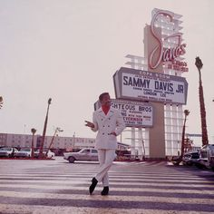 Sammy Davis Jr.  Milton Greene photographed Sammy Davis Jr. in 1967, posing in front of the Copa Room nightclub at the Sands Hotel in Las Vegas where Davis was a featuring act.