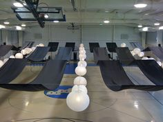 Decorating a gym with strips of fabric and lanterns!!