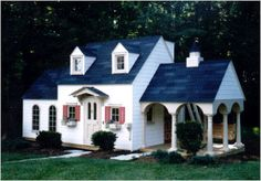 This variation of the Cotton Candy Manor incorporates a grand side porch with five round columns, cupola and porch swing.