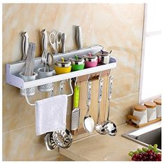 """Something similar to this for outdoor kitchen. Hang cloth, bbq utensils, s n p, seasonings etc. 24"""" wide???"""