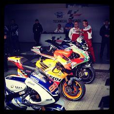 MotoGP. Jorge Lorenzo's Yamaha, Dani Pedrosa's Honda HRC and Valentino Rossi's Ducati at MotoGP's parc ferme. #MotoGP