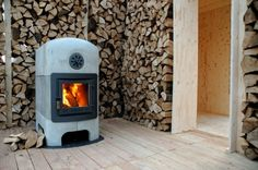 "Wood-burning stove designed by Dick van Hoff. Authentic use of materials in a robust design. Steel interior and cased by concrete elements. With a visible woodfire in an industrial stove, the Stonestove is a modern translation of a traditional heating concept: long-lasting and comfortable. Dick van Hoff about the Stonestove: ""When you choose to have this stove in your home, you are making a clear-cut decision. It's always there, like a large domestic pet, never in the background."