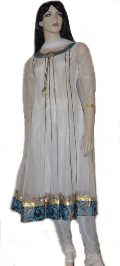 This White  colored  readymade net churidar Anarkali style kameez is adorned with  beautiful gold  zari, patch patti and a lovely blue brocade border . Matching churidar and attractive dupatta comes along with it. Slight variation in color and patch patti is possible. This Anarkali has net sleeves.