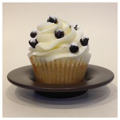 Cannoli Cupcake- Vanilla chocolate chip cake filled with ricotta cream topped with ricotta buttercream