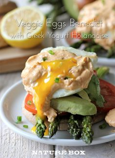 It's Meatless Monday so why not serve up lightened up eggs benedict on toasted whole grain English muffins with roasted asparagus and a spicy chipotle Greek yogurt hollandaise?