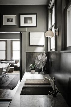 Love the drama of dark gray rooms. Looks great w/ black & white photos