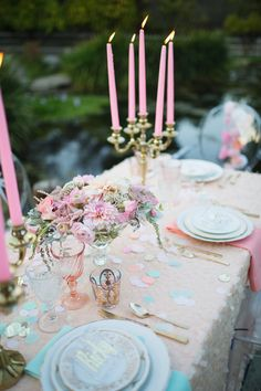 Pink, gold and white dining table with pastel confetti, tall pink candles and gold candelabras. Romantic dinner table design. | Retro Pastel Inspired Shoot | Lovelyfest Event Design