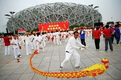 People celebrate after Beijing was chosen to host the 2022 Winter Olympics at the Bird's Nest