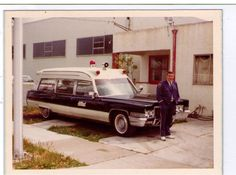 """Bob Curry, in almost the full Silva's uniform (no badge), posing with a """"new"""" ambulance, formerly used by Allied Ambulance in Oakland. 1974."""