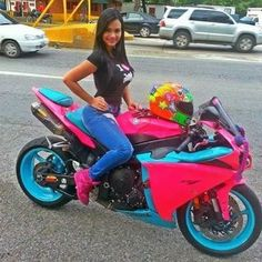 Bright , fun, and cute, both the bike and girl.