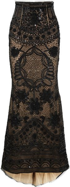 EMILIO PUCCI  Black sheer tulle. Black sequin embellishment, embroidered web pattern, crocheted flower details, frayed mesh trim at waist, fishtail hem, sand underlay.