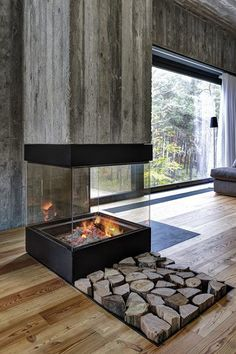 Love the walls and fireplace. Hate the stones #random. By Ultra Architects