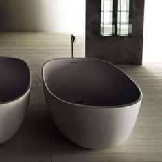 10 Easy Pieces: Modern Bathtubs - Remodelista Concrete Bathtub, Stone Bathtub, Jacuzzi Bathtub, Freestanding Bathtub, Bathtub Sizes, Modern Bathtub, Big Tub, Boffi, Bathtub Remodel