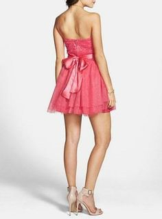 Pink Princess! Love the sweet satin bow on this prom dress.
