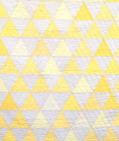 Yellow equilateral triangles crib or wall quilt by CarsonToo at Etsy.  The pairing of yellow with pearl gray is so much more soothing than yellow with white.