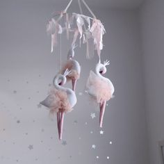 3 mini liliana flamingos make up this beautiful mobile.Each flamingo is stuffed by hand  and hand painted  and wear  pretty peach blush bridal tulle wings.The fabrics used for the ring are tulle, natural cotton ,  and natural fabrics  dyed by hand with natural plant dyes It is a statement piece that will add a sprinkle of magic to any room.This is intended for decorative purposes only, please hang out of reach of babies and children