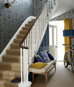 Wilton Wallpaper A block print style damask wallpaper in semi reflective gold on sovereign blue.