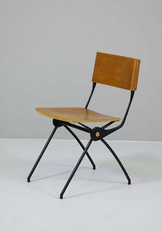 Carlo di Carli; Enameled Metal, Molded Plywood and Brass Side Chair for Tecno, 1956.