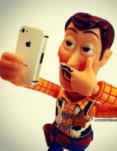 This TOTALLY describes this century! Woody with a finger mustache taking a selfie with an iPhone! Totally nailed the definition of the 21st century!