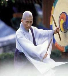 Buddhist nun striking a taiko world-music