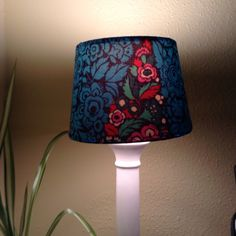 Re covered old lampshade for daughter.