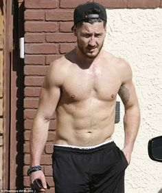 That's a six pack:Val Chmerkovskiy showed off his toned torso as he left rehearsals on Friday