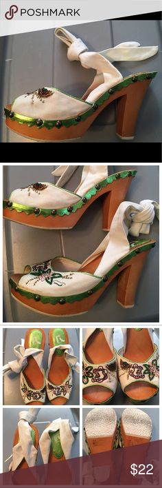 """Strappy Platform Sandals Cute and unique shoes worn only one time. In excellent almost new condition. Only flaw noted is a spot on one of the white ties that should wash out. Wooded heel/detailing. Estimated measurements are: Heel - """"4 1/2, Platform- """"1 1/2. Report Shoes Sandals"""