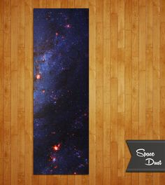 Space Dust (M74) Yoga Mat Your consciousness can literally span the cosmos. But you are here now on a yoga mat. Become one, become you. 1/4″/6.2mm thick.  Phthalate-free mat with sustainable UV-cured inks.  Printed in South Carolina, USA.