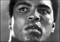 """Ali's mountaintop training camp in Deer Lake, Pa., 1977  -  Michael Brennan: """"I had attempted this picture on numerous previous occasions, with no success. Ali and I both needed to be precisely where we were at that exact moment for this image to exist. As he prepared for his 1977 collision with the dangerous and fearsome puncher Earnie Shavers, it all came together in one moment for this ever inspiring image. The picture was taken at Muhammad's mountaintop training camp at Deer Lake during his preparation for his Sept. 29 bout with Shavers held at New York City's Madison Square Garden. It was probably taken on Sept. 17. Ali was down on most of the judges' cards going into the last rounds. However, he produced a masterful final three minutes to pull off a controversial victory. Many years later, he ran his right index finger over the photo and whispered to no one in particular, 'I can feel the texture of all the sweat and hard work. I can feel my life.' The portrait, titled 1977, is now part of the permanent collection of the National Portrait Gallery in Washington, D.C."""" Michael Brennan is a documentary and celebrity photographer."""