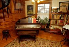 ANN WILLIAMSON/THE CAPITAL-JOURNAL-The home of David and Susan Ohse at 1215 S.W. Mulvane - one of five on this year's Elmhurst Neighborhood Open House - features oak trim throughout the first floor, which includes a music area at the base of the stairway.