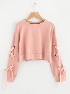 Shop Eyelet Lace Up Sleeve Crop Sweatshirt online. SheIn offers Eyelet Lace Up Sleeve Crop Sweatshirt & more to fit your fashionable needs.